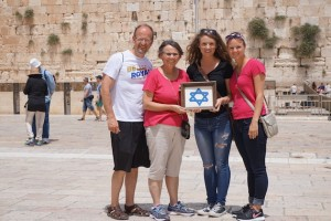 We visited the Western Wall twice. Once during mid-day wit light crowds and then again on Shabbat when young Jews danced and celebrated as they ushered in their day of rest. Here, we are pictured holding a Star of David that Anita's late mother made and framed in the 80s while Anita lived and worked in Israel.
