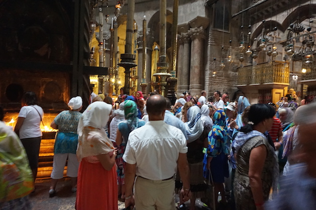 Tourists and pilgrims line for a view inside the Church of the Holy Sepulchre.